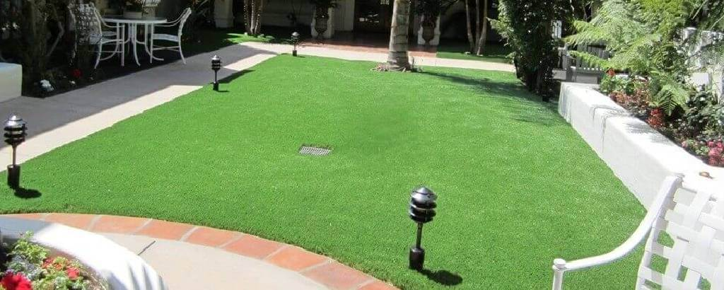 Commercial dining area decorated with turf now artificial turf